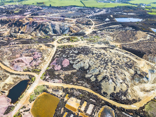 The colourful remains of the former copper mine Parys Mountain near Amlwch on the Isle of Anglesey, Wales, UK