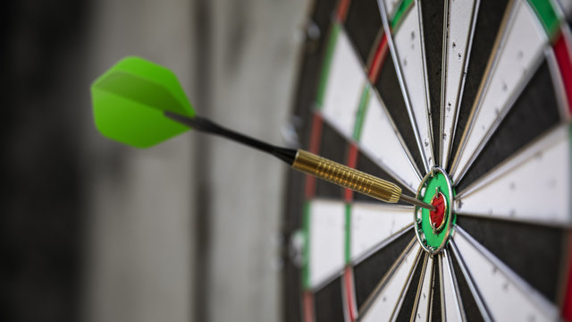 a typical darts game with dart in the bullseye