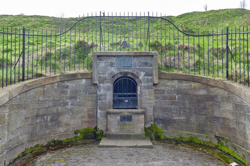 The remain of the ancient Well House located at the foothill of Holyrood Park in Edinburgh, Scotland, UK
