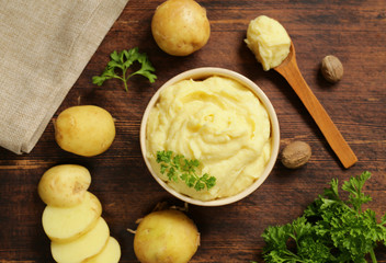 fresh organic mashed potatoes on a wooden table