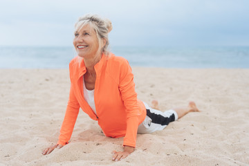 Woman working out on a sandy beach