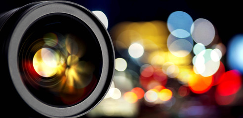 dslr camera lens with bokeh reflections. camera lens background