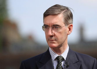 Brexit campaigner Jacob Rees-Mogg talks to the media outside the Houses of Parliament after David Davis resigns from government, in London