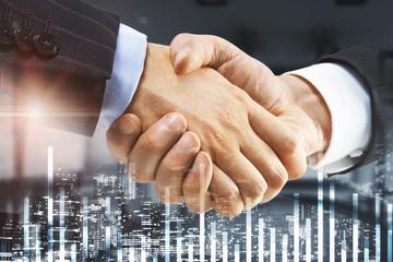 businessman handshake and business chart