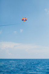 Printed roller blinds Water Motor sports People flying on a colorful parachute towed by a motor boat