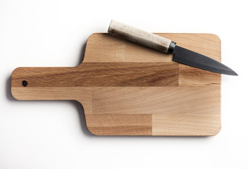 Wooden chopping board and knife on a white background Wall mural