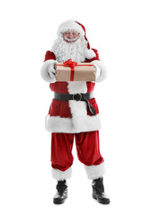 Authentic Santa Claus with gift box on white background
