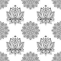 Seamless decorative pattern in ethnic oriental style. Mandala and Lotus flower in mehndi style.