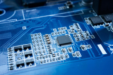 Electronic circuits in futuristic technology concept. Motherboard computer on blue background. Microchip digital data