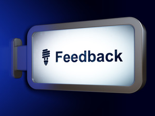 Finance concept: Feedback and Energy Saving Lamp on advertising billboard background, 3D rendering