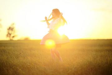 Happy girl running in the summer field