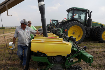 Bruce Edler, 56, a farmer for 40 years, fills seed planters with soybean seed in Gideon, Missouri