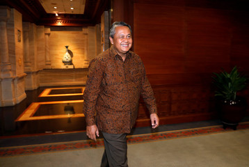Bank Indonesia's new governor Perry Warjiyo walks after an interview at Bank Indonesia's headquarters in Jakarta