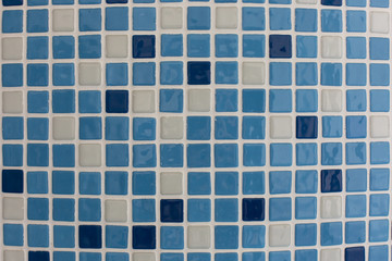blue square ceramic tiles in the pool or bathroom pattern texture background