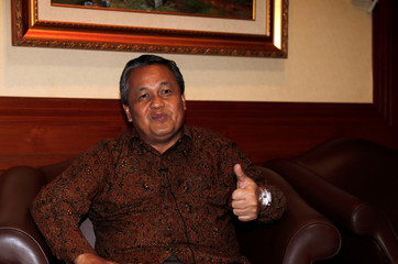 Bank Indonesia's new governor Perry Warjiyo gestures during an interview at Bank Indonesia's headquarters in Jakarta