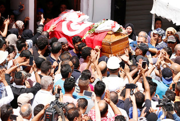 Mourners carry the coffin of Anis El Werghi, a Tunisian security forces member, who was killed on Sunday in an ambush in the northwest of the country, during his funeral in Tunis