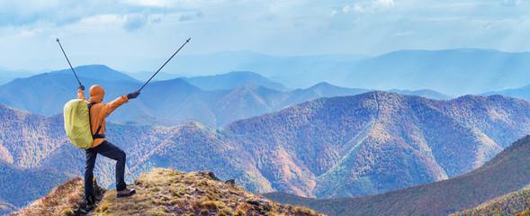 Hiker enjoying trip in the top of mountain.
