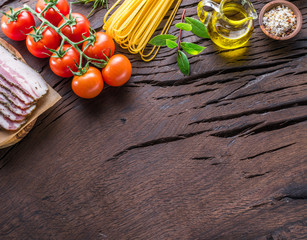 Variety of food on the wooden table. Top view.