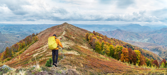 Hiker enjoying the trip in the top of mountain.