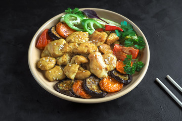 Pieces of baked meat with grilled vegetables on a plate. Chinese cuisine.