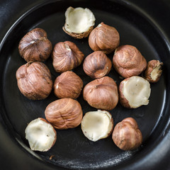 Hazelnuts nuts in bowl. Food background. Close up