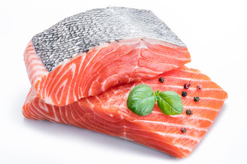 Fresh raw salmon fillets  decorated with green basil.