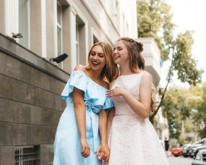 Two girls having a walk on the streets of city - street photo in Kharkov (Ukraine)