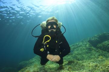 Blonde woman scuba diver