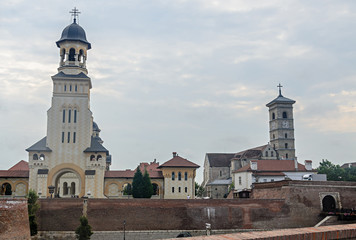 ALBA IULIA, ROMANIA - AUGUST 6, 2017: Citadel fortress Alba Carolina, detail of the gate and the church
