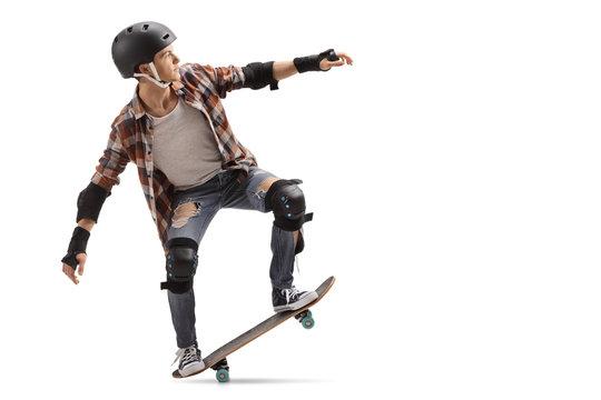 Teenage skater performing a manual
