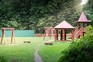 Modern unusual bright wooden playground (children's lodge) in the new suburban residential complex.