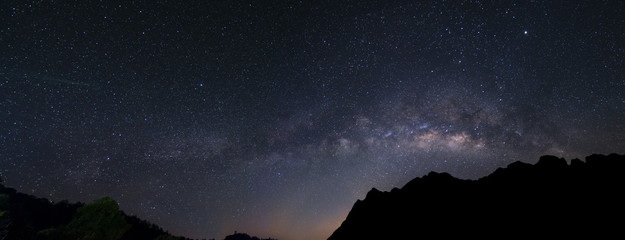 panorama milky way galaxy over mountain in dawn