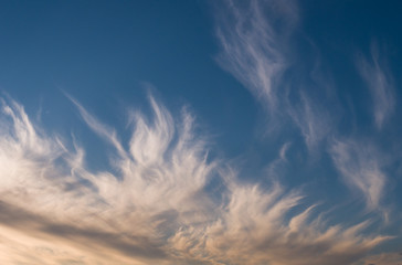 Beautiful clouds at sunset, warm summer evening