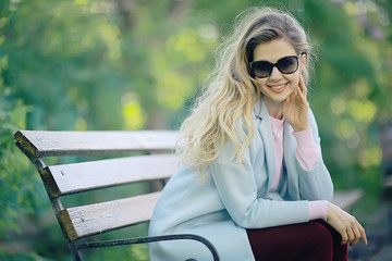 portrait of a european beautiful female model wearing sunglasses / girl outdoors walking, happy cheerful girl wearing glasses