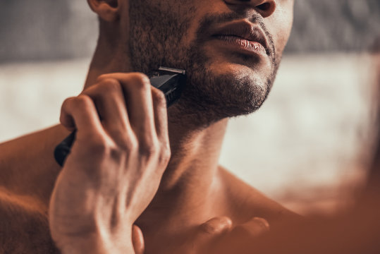 Close up. Afro-American Man Shaving in Bathroom.
