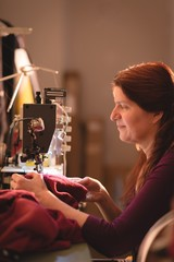 Tailor sewing cloth with sewing machine