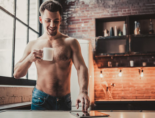 Bare-chested Man Using Tablet and Drink Coffee.
