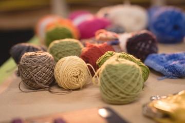 Multicolored wool kept on table