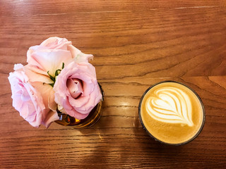 flowers and coffee on the wooden table