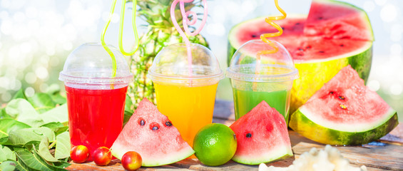 Bright Fresh healthy juices, fruit, pineapple, watermelon. sunglasses yoga mat on the background of the sea. Summer, rest, healthy lifestyle Close up