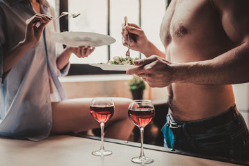 Close up. Young Couple Have Dinner and Drink Wine.