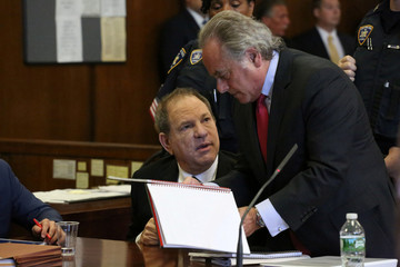 Film producer Harvey Weinstein speaks to his lawyer Benjamin Brafman inside Manhattan Criminal Court during an arraignment in the Manhattan borough of New York