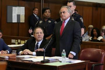 Film producer Harvey Weinstein sits next to his lawyer Benjamin Brafman inside Manhattan Criminal Court during an arraignment in the Manhattan borough of New York