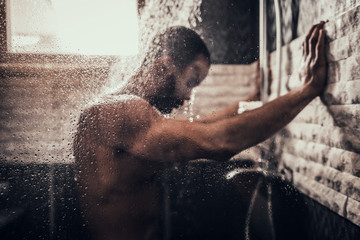 Young Afro-American Man Taking Shower in Bathroom.