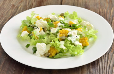 Salad with corn, greens, feta with mayonnaise sauce