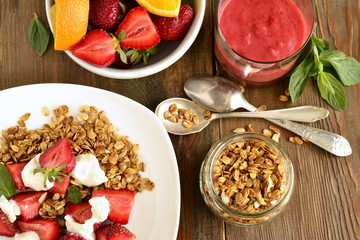 Fresh strawberries, yogurt and homemade granola for  healthy breakfast, top view