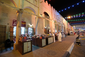 Saudi men are seen outside their shops in Souq Al Qaisariya now known as Al Ahsa World Heritage UNESCO Village after it was added to UNESCO World Heritage site, in Al Ahsa
