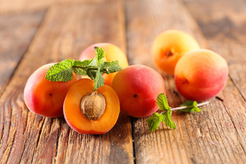 fresh apricot on wood background