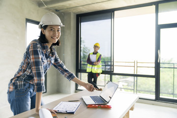 woman civil architech engineer discuss or brain stroming work with collegue ,engineering and architecture concept.Blue print is fake only for stock photo.