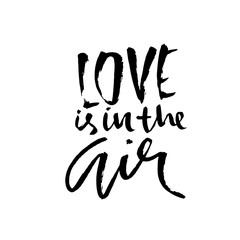 Love is in the air. Handdrawn calligraphy for Valentine day. Ink illustration. Modern dry brush lettering. Vector illustration.
